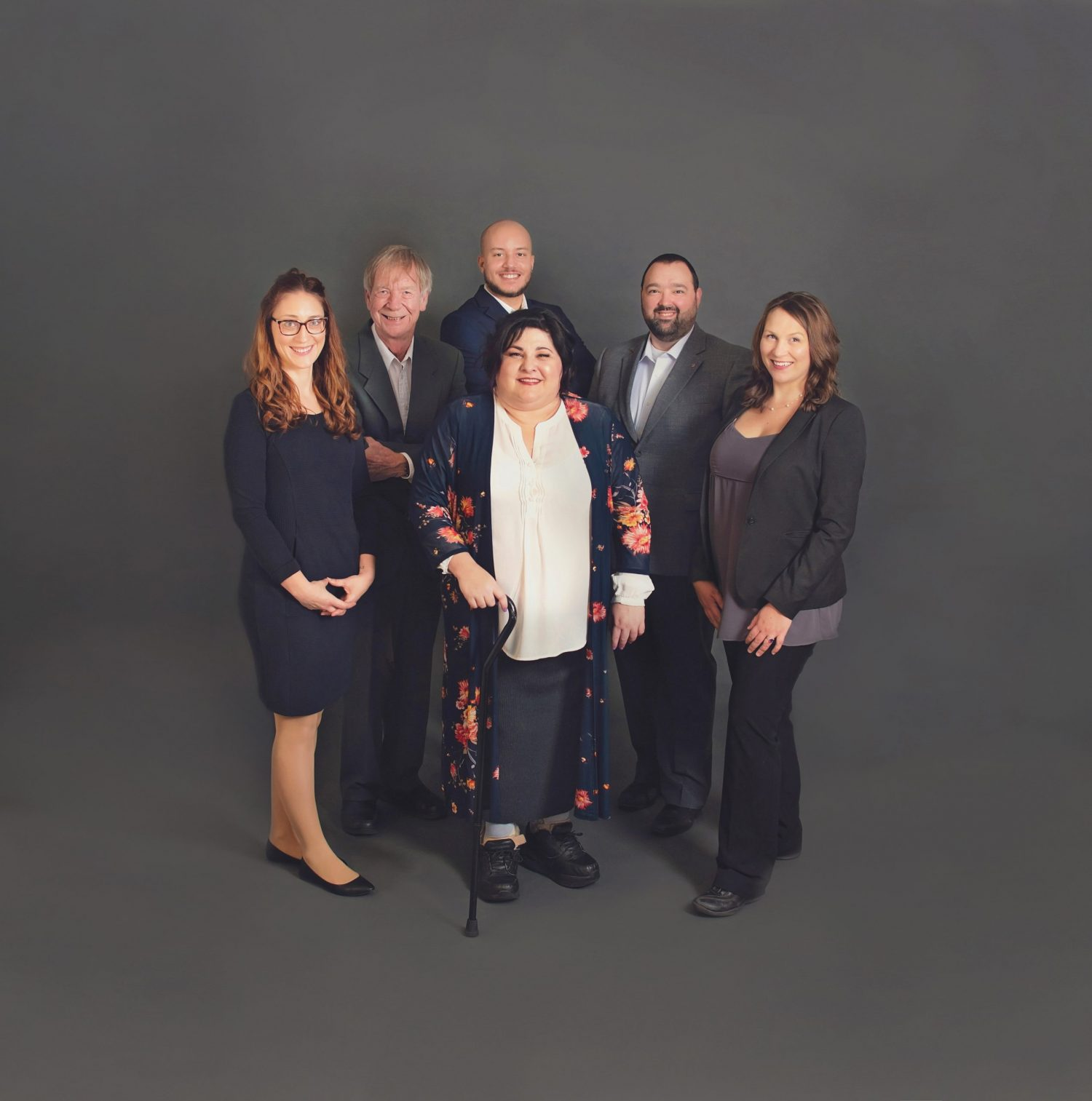 Photo of The Herrington Group staff in business attire