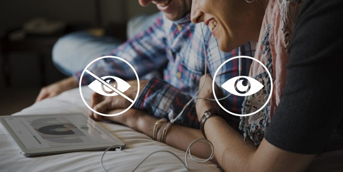 2 people reading a tablet with the symbols for low vision superimposed on the photo