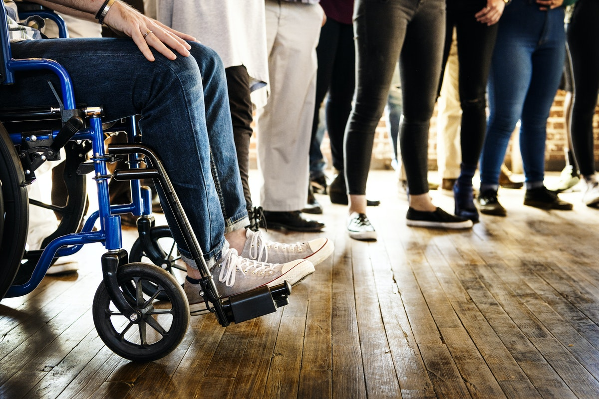 A group of people, one in a wheelchair